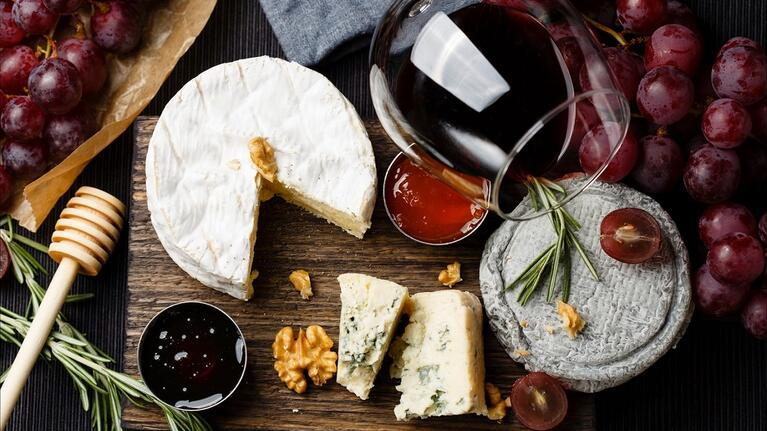Glass of wine with a cheese board